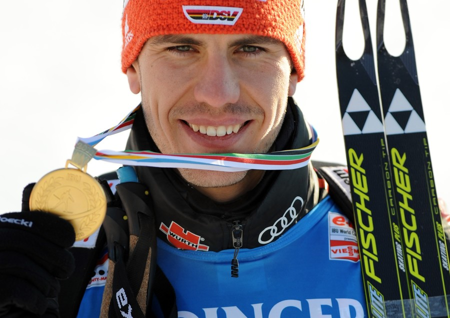 German Arnd Peiffer poses with his gold